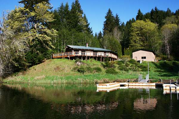 Our Waterfront House has a private driveway, dock and a full wraparound deck to enjoy the lovely views of Loon Lake