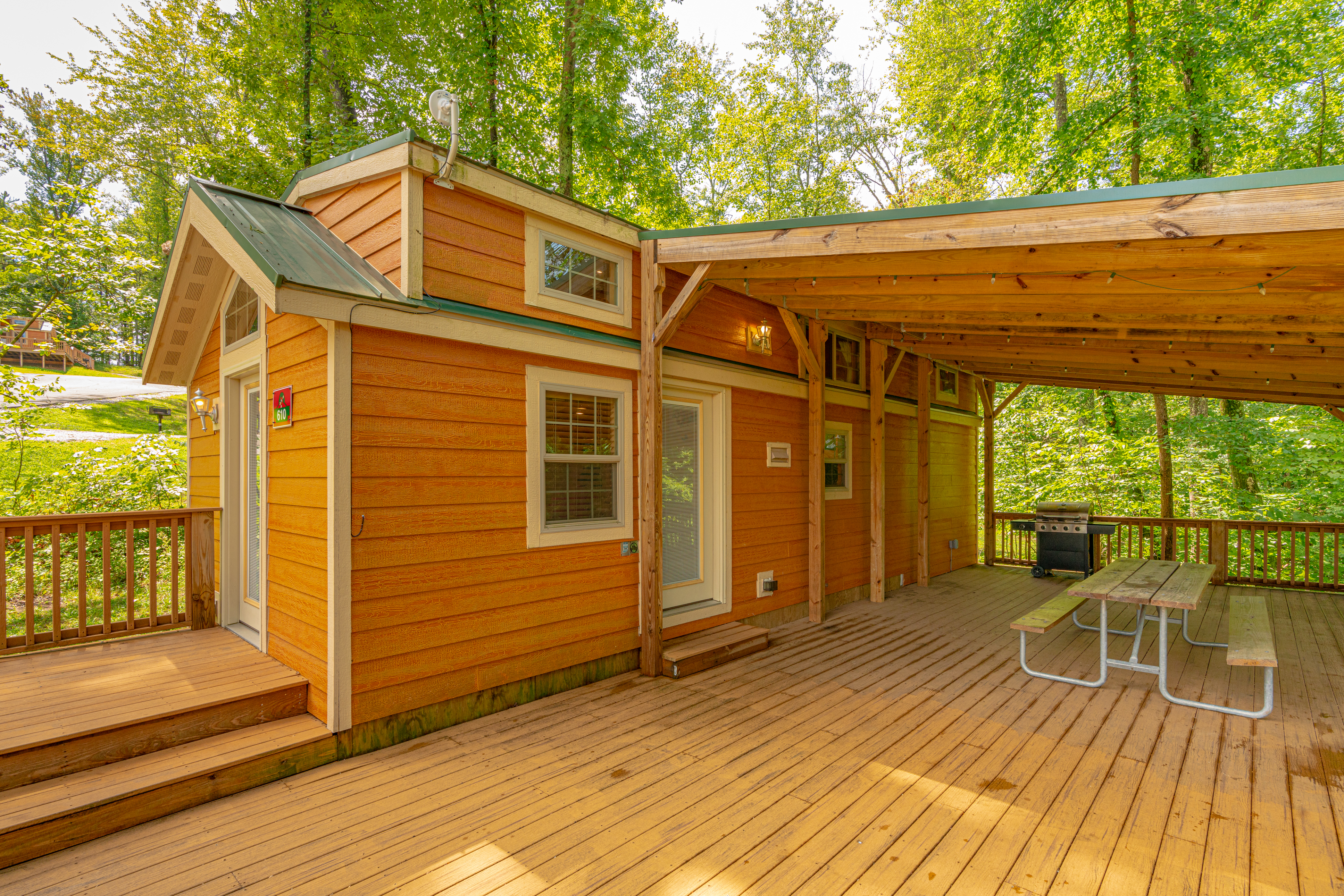 Christmas Cabin with large deck at Lake Rudolph Campground & RV Resort in Santa Claus, Indiana