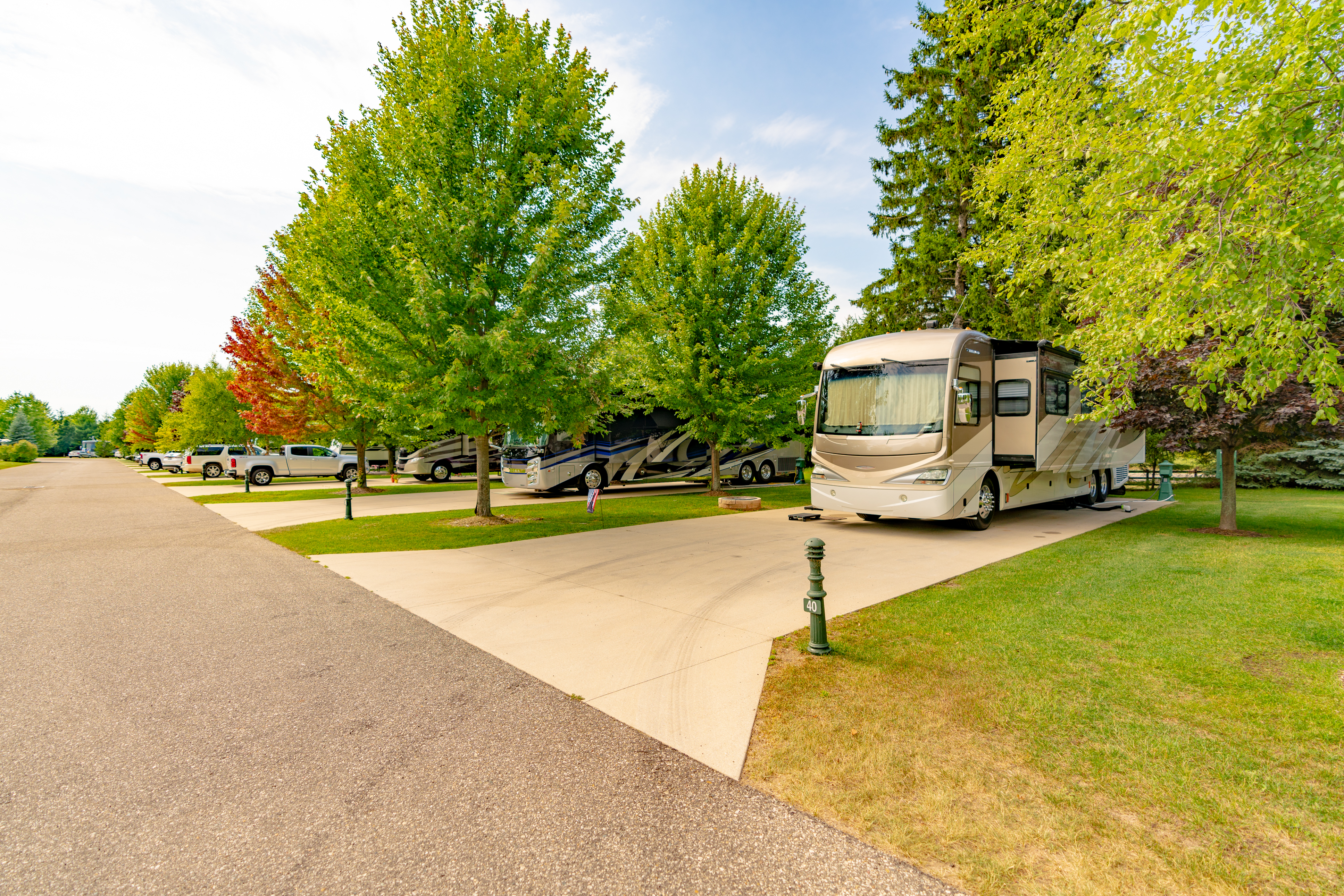 Large full hookup RV sites with concrete pads at Petoskey RV Resort in Petoskey, Michigan