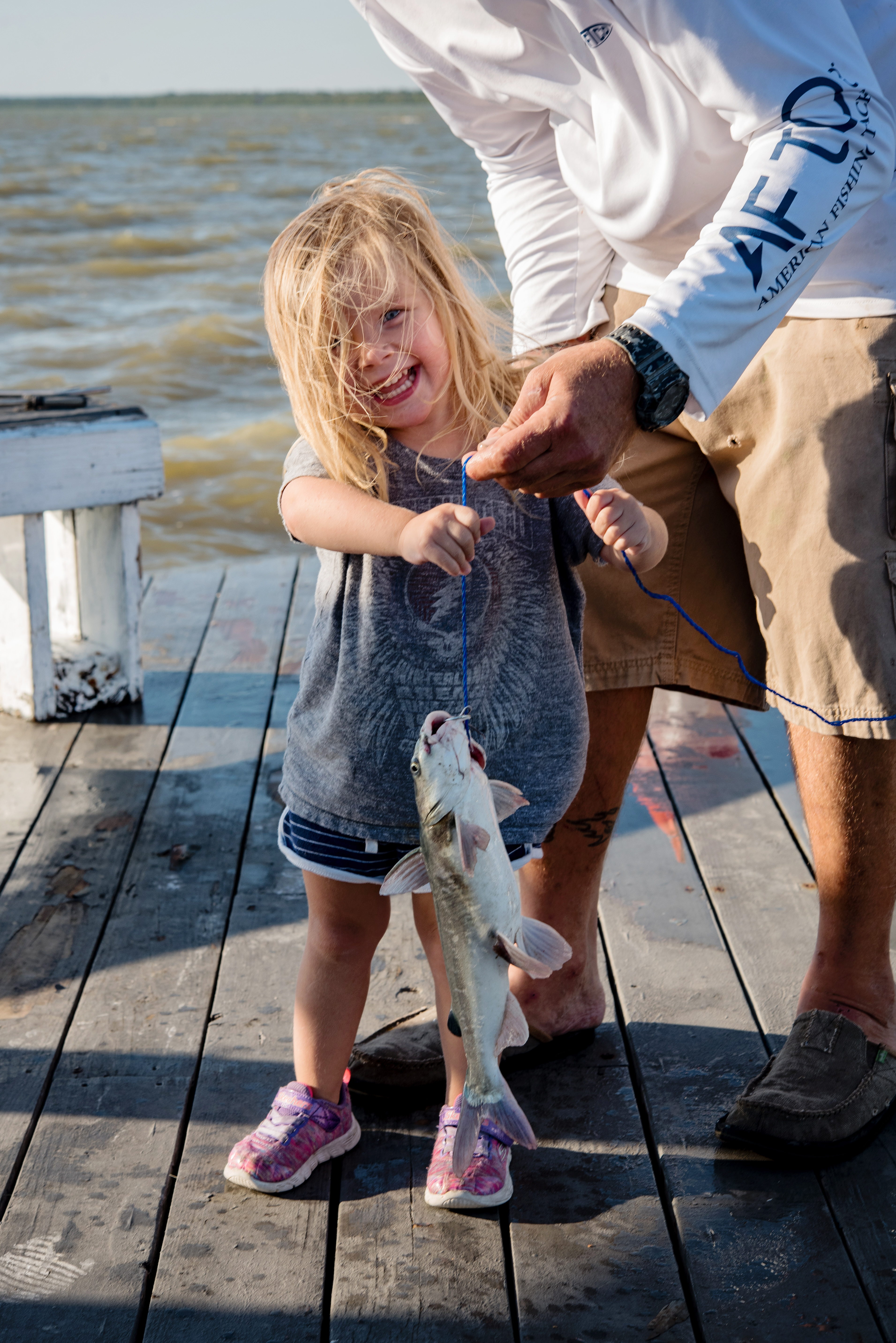 Little fisherman showing off their catch.