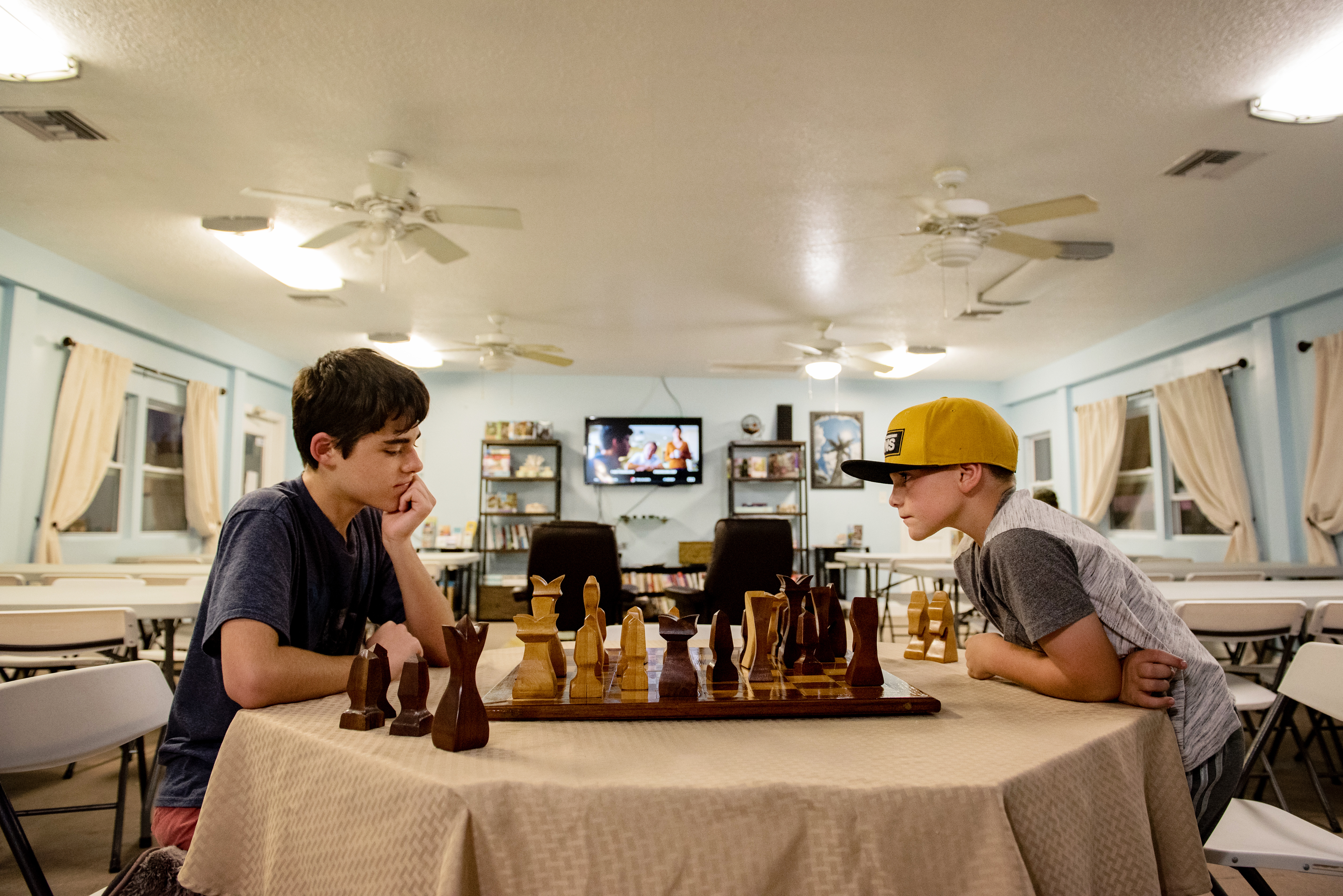 Some of the guests playing chess in the recreational hall.
