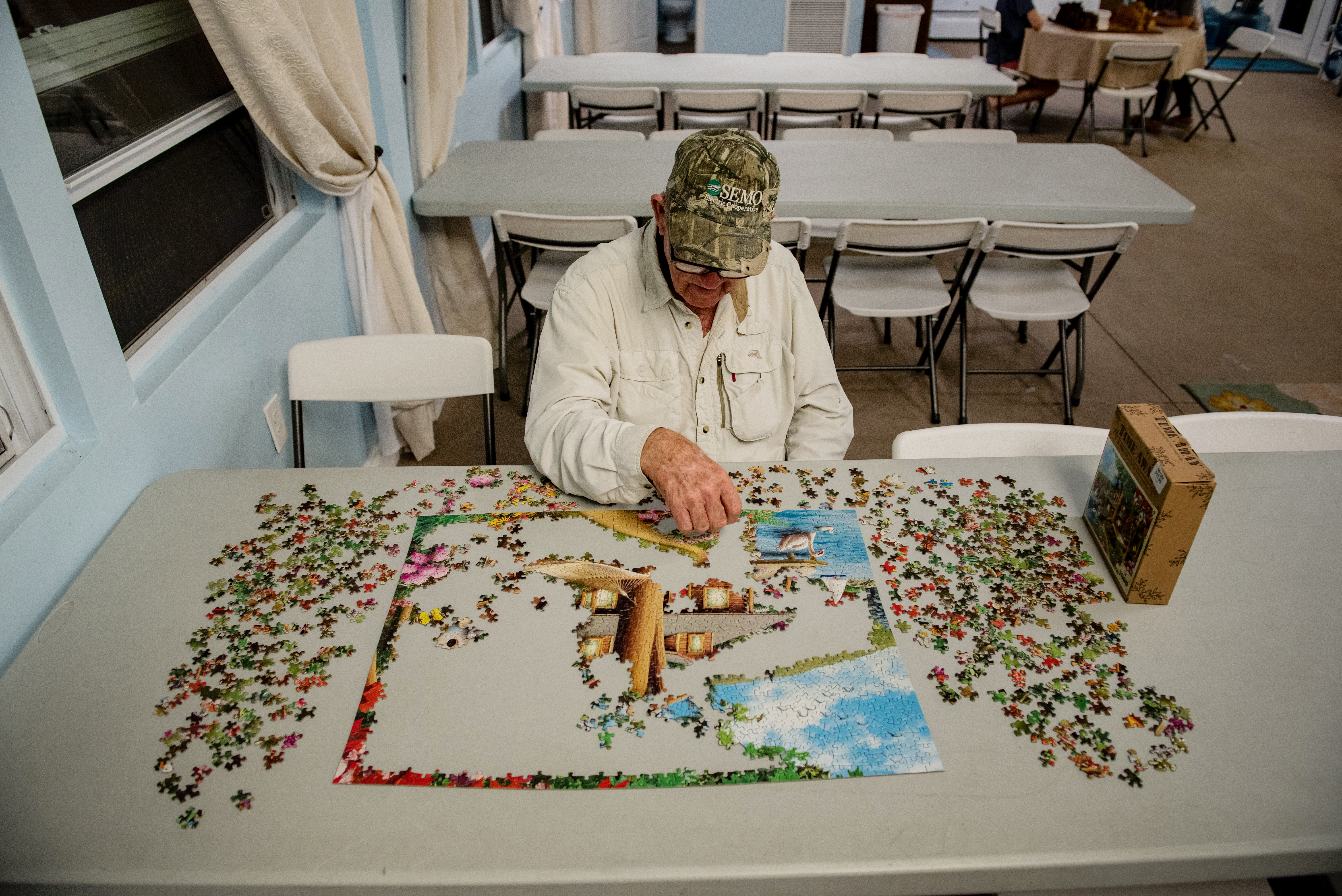 One of our guests putting together a puzzle at the recreational hall.