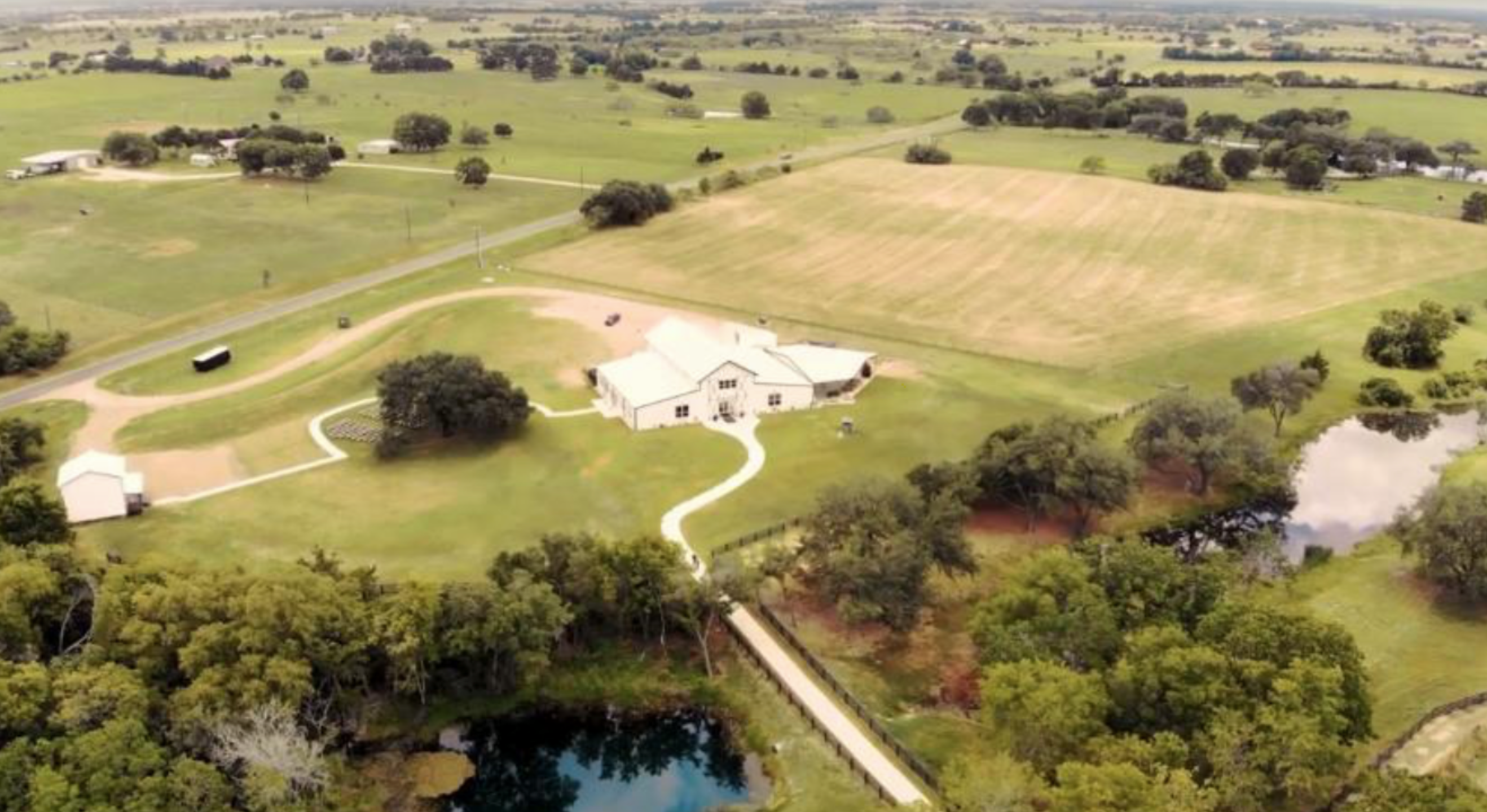 Ariel view of the beautiful grounds; covered outdoor bar & patio